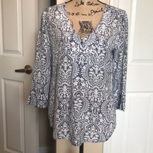 Blouse. Gray and White print. Size M